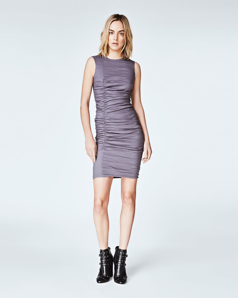 BS10162 - SOLID COTTON METAL TUCK DRESS - dresses - short - In our signature cotton metal, this sleeveless dress features a form fitting silhouette. Crafted with mindful tucking, this sheath dress is perfectfor the office or a special occasion. Finished with a concealed zipper for closure and a fully lined. Alternate View