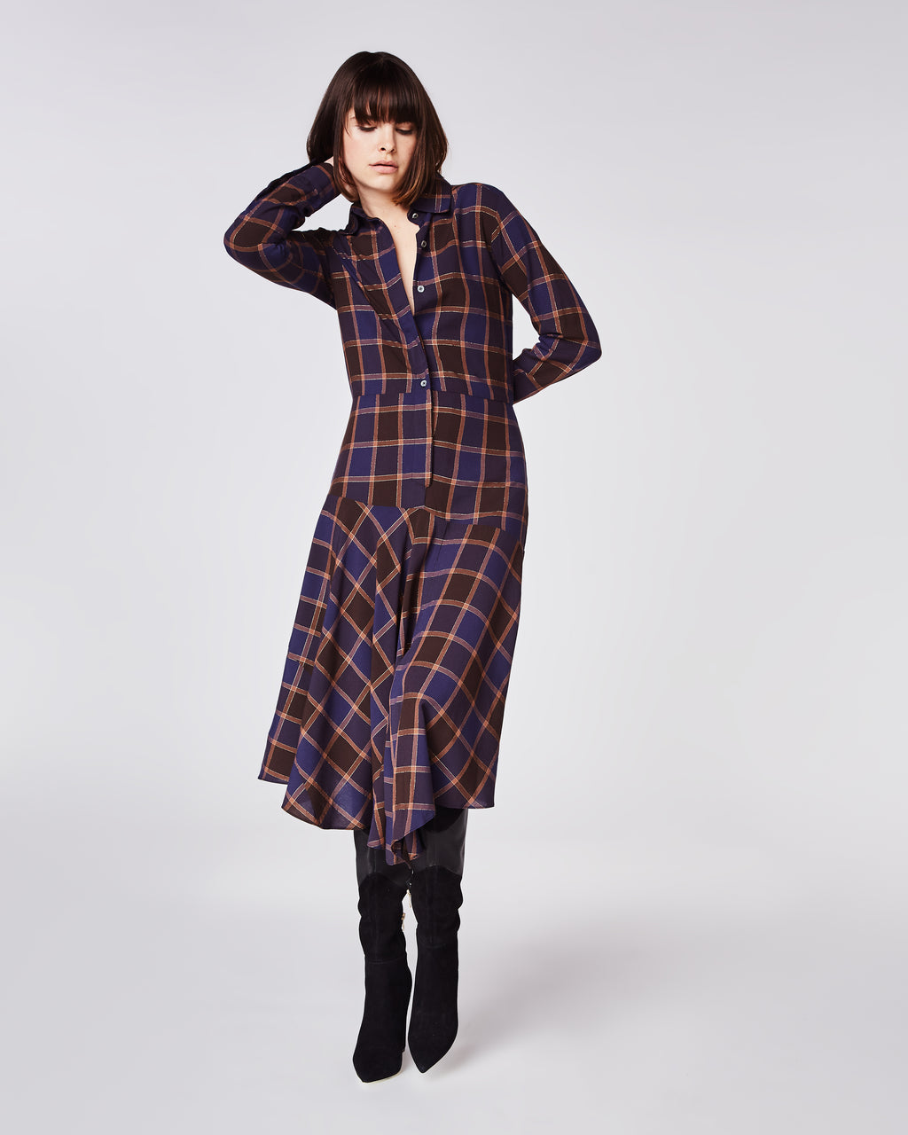BS10163 - BOYFRIEND PLAID HANDKERCHIEF SHIRT DRESS - dresses - midi - In a modern blue and orange plaid, this long sleeve dress features a drop waist and button downclosure. Paired with sneakers for a casual day time look or boots for an evening out.