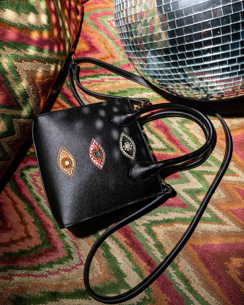 CA00002 - EVIL EYE NIKI MINI HANDBAG - accessories - bags - Made a big statement with our mini bag. Our classic Niki mini bag is updated with our signature jeweled evil eye patches. Feauturing two inside pockets, a removable and adustable strap and hidden magnetic button closure. Alternate View