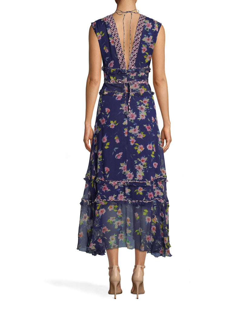CA10271 - COSMO FLORA MIDI DRESS - dresses - midi - A LITTLE BIT OF FLORA. THIS MIDI DRESS IS A TRUE STUNNER. FUN FLORALS COVER THE BODY AND THE HEM HITS JUST ABOVE THE ANKLE. FEATURING A SHIMMERY TIE WAIST AND THICK STRAPS. PAIR WITH NUDE HEELS FOR A COMPLETE LOOK. Final Sale Alternate View