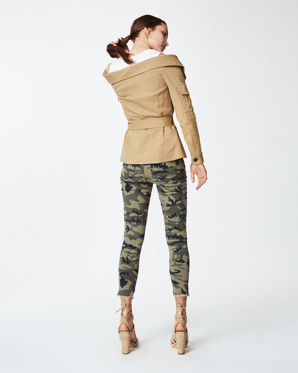 CC10166 - OFF THE SHOULDER JACKET - outerwear - jackets - In a safari-like khaki hue, this cotton jacket is a versatile piece that can be worn year round. With a cotton ribbed, detachable crop top this can be worn as a top or along with a silk blouse. Finished with tarnished front buttons for closure and belt. Fully lined. Final Sale