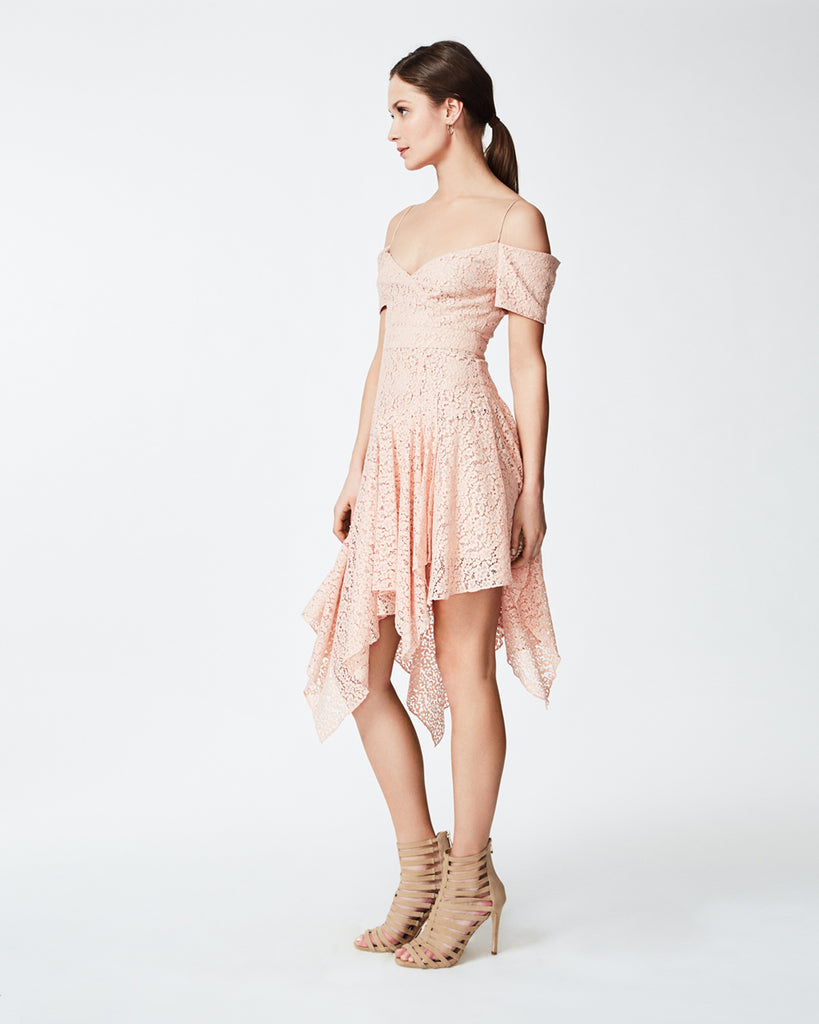CC10167 - LACE SCARF DRESS - dresses - long - In a soft blush hue, this lace dress is crafted in a mini flora and an asymmetric hemline. The thin straps suspend the dress into a faux wrap neckline for a trendy look. Finished with a concealed zipper for closure and fully lined. FINAL SALE Alternate View