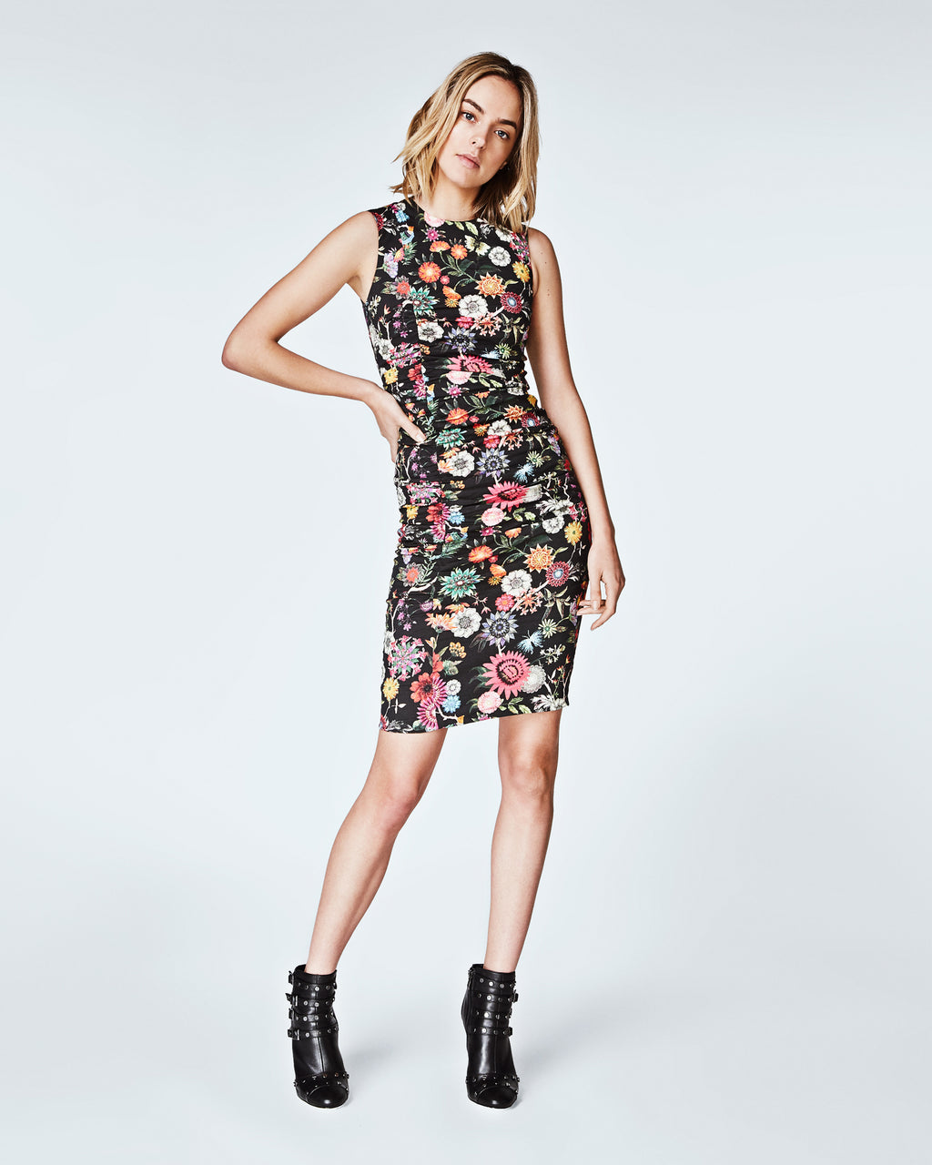 CC10178 - FLORAL NECTARY TUCK DRESS - dresses - short - Vibrant florals splashed on a black cotton metal canvas bring a fun vibe to this sleeveless sheath dress. Skillfull tucking create a form flattering figure. Fully lined.