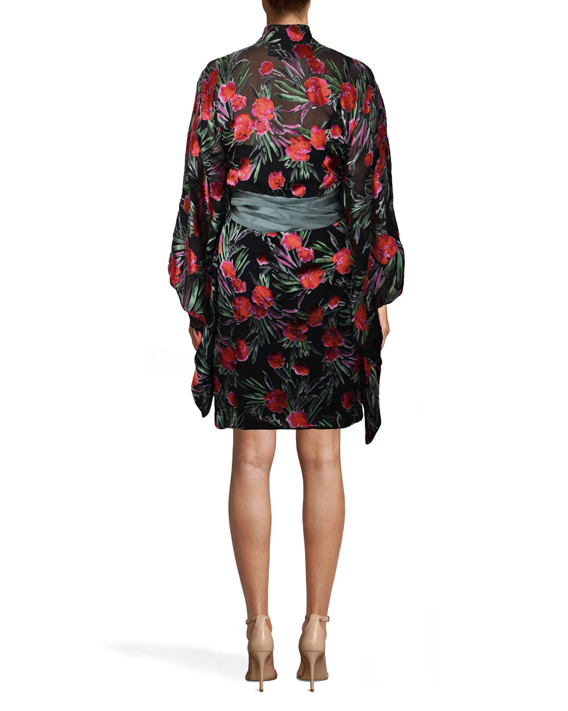 CD10099 - SPRING GARDEN KIMONO DRESS - dresses - short - OUR SPRING GARDEN KIMONO DRESS IS AN ABSOLUTE SHOWSTOPPER. THIS WRAP DRESS IS CRAFTED FROM A SILK BLEND AND HAS THE ULTIMATE STATEMENT SLEEVE. THIS PIECE IS HAS A BLACK SLIP UNDERNEATH AND IS CINCHED AT THE WAIST WITH A GREEN SATIN BELT. Final Sale Alternate View