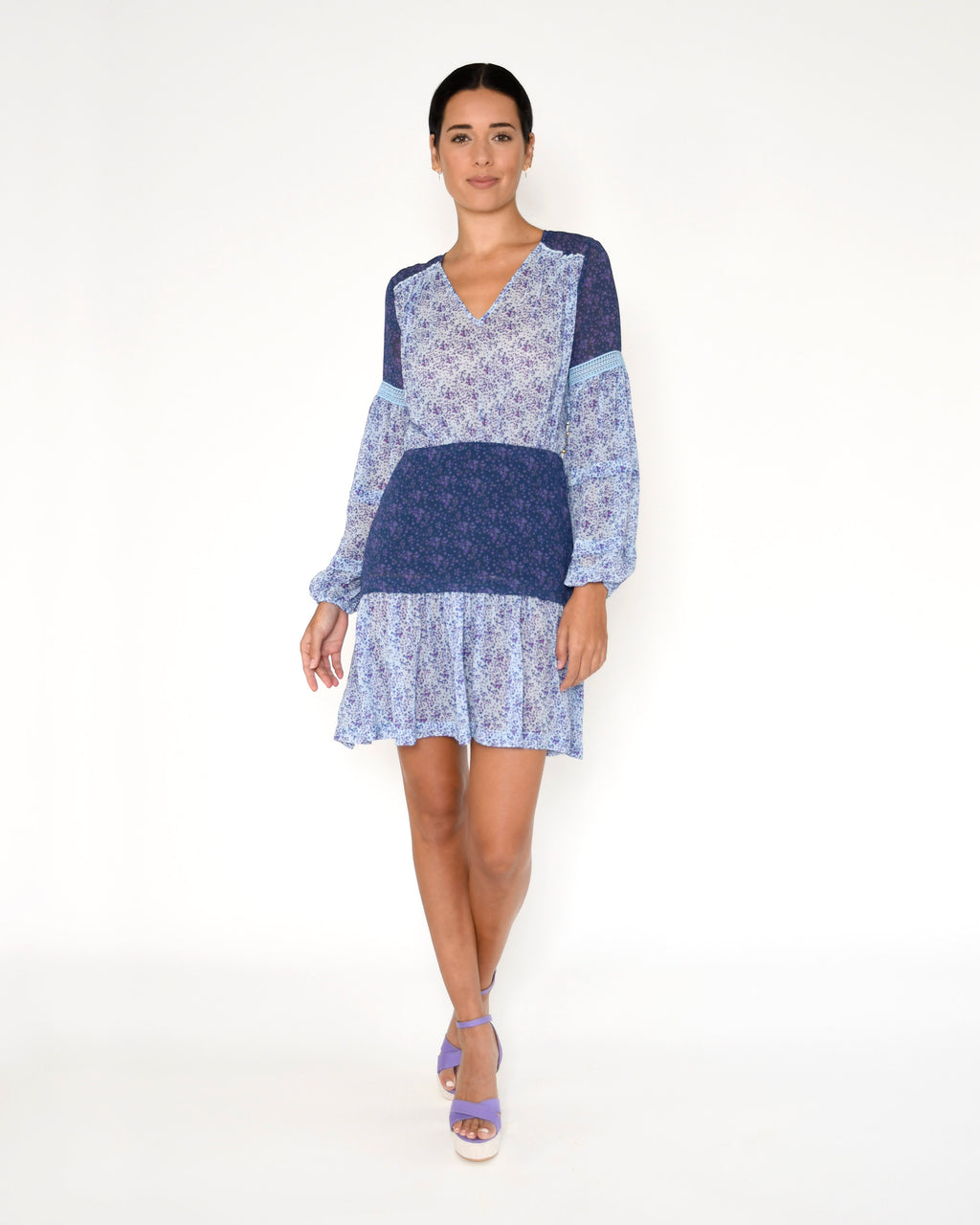 CD18418 - MAMA DITSY MINI DRESS - dresses - short - This mini dress is designed in our vibrant mama ditsy print, featuring delicate flowers in a range of blues. Designed in a billowy fabric, this simple yet stunning dress features long sleeves with lace detailing and gold buttons along the side for closure. Add 1 line break Stylist Tip: Dress down with fashion sneakers or up with heels.