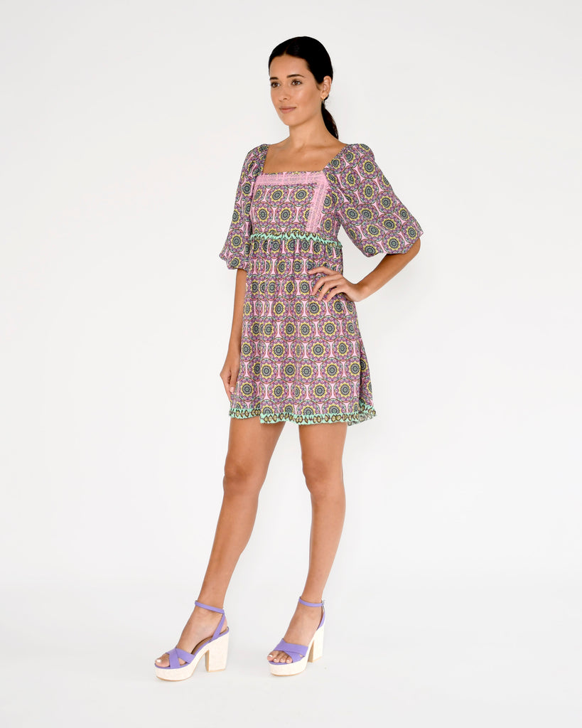 CD18683 - GLASSFLOWER SQUARE NECK MINI DRESS - dresses - short - Wear this square neck mini dress for the ultimate pop of color. This easy dress features a lace detailing, a smocked back and puffed sleeves. Add 1 line break Stylist Tip: Style with sneakers for a cute daytime look. Alternate View