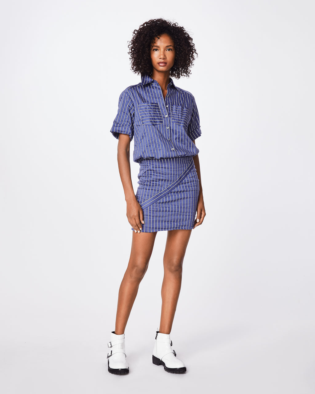 CE10128 - STRIPED COTTON METAL BUTTON DOWN SHIRT DRESS - dresses - short - Work to play. Our iconic Cotton Metal fabric has a wrinkled-like appearance that feels super comfortable, making this button down shirt dress an easy go-to. The collared neck and white striping give off a casual feel, while the skirt's form-fitting fit elevates. Pair with sneakers or boots.
