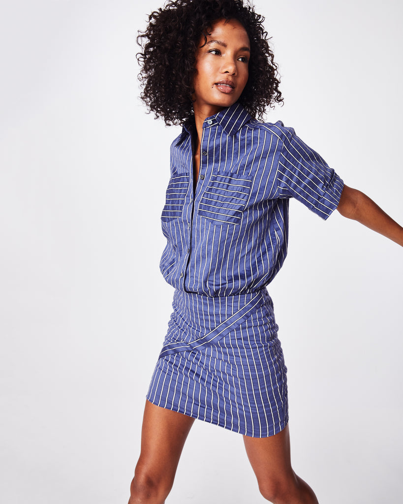 CE10128 - STRIPED COTTON METAL BUTTON DOWN SHIRT DRESS - dresses - short - Work to play. Our iconic Cotton Metal fabric has a wrinkled-like appearance that feels super comfortable, making this button down shirt dress an easy go-to. The collared neck and white striping give off a casual feel, while the skirt's form-fitting fit elevates. Pair with sneakers or boots. Alternate View