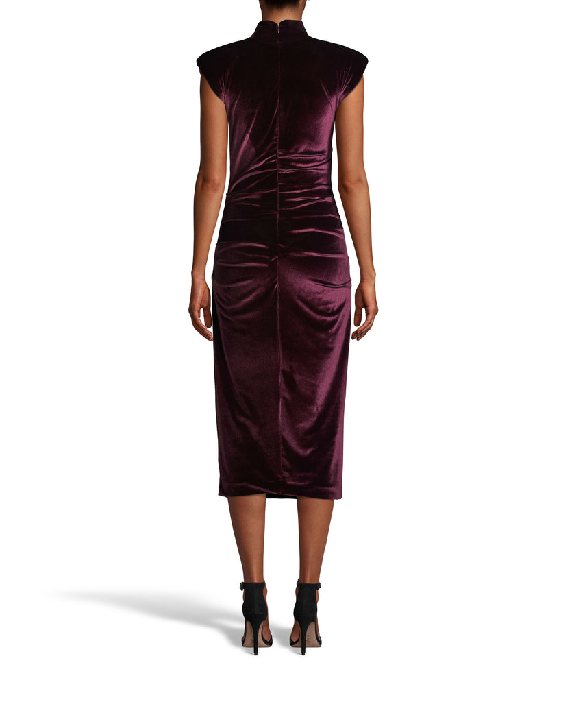 CE18117 - STRETCH VELVET MOCK NECK MIDI DRESS - dresses - midi - Crafted from ultra soft velvet in rich indigo or burdundy, this dress is true showstopper. Featuring on trend shoulder pads, a slight mock neck and figure flattering fabric tucking throughout. Concealed back zipper for closure. Add 1 line break Stylist tip: Pair with neutral heels and a statement clutch. Alternate View