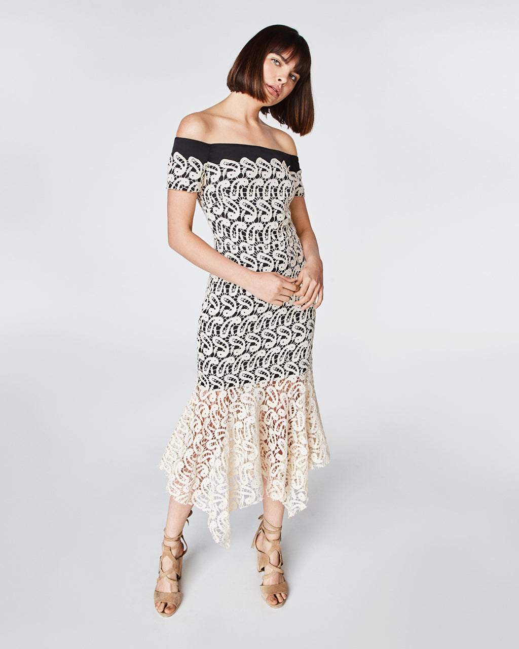 CF10226 - BARDOT DRESS - dresses - midi - In an off the shoulder silhouette, this midi dress features white lace with a contrasting black lining. The unlined dress falls to a mid-calf length at an asymmetrical hemline. Pair with a simple black sandal for a completed look. Final Sale