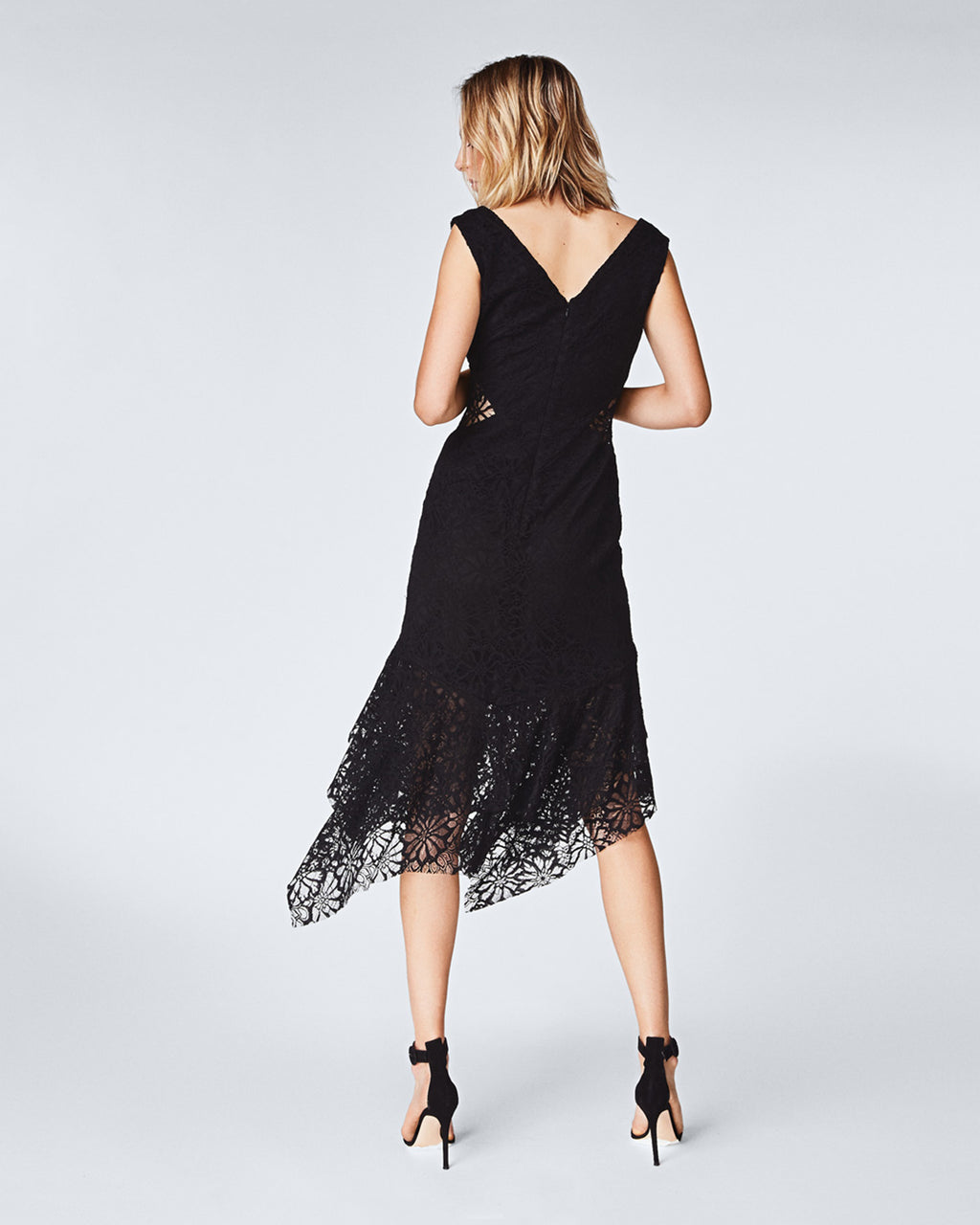 CF10227 - SUMMER LACE DRESS - dresses - midi - In an off the shoulder silhouette, this midi dress features white lace with a contrasting black lining. The unlined dress falls to a mid-calf length at an asymmetrical hemline. Pair with a simple black sandal for a completed look. final sale