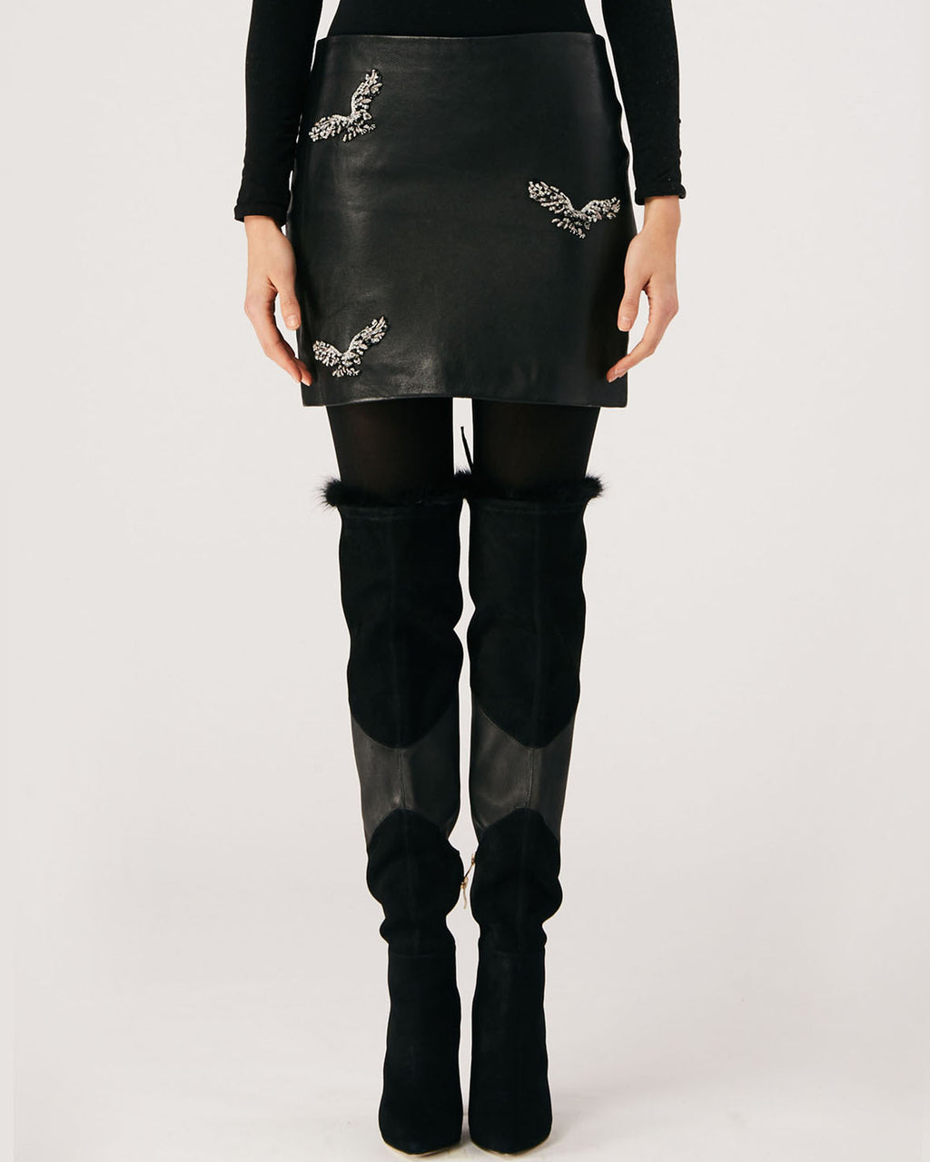 CF10242 - EMBELLISHED EAGLE MINI SKIRT - bottoms - skirts - This 100% leather mini skirt features embellished eagles and an exposed zipper for closure. Fully lined.