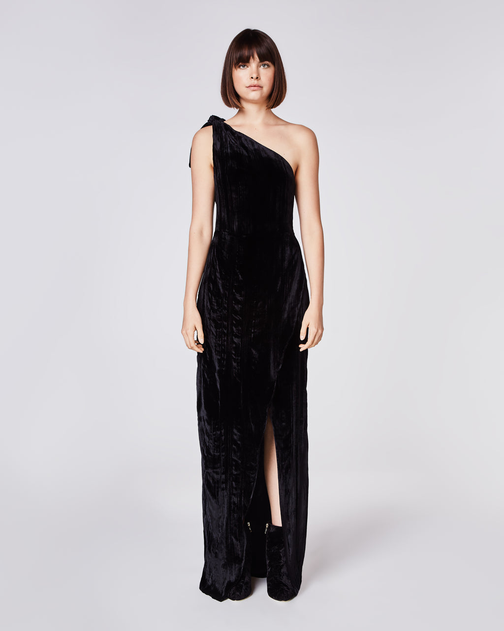 CF10244 - CRINKLED VELVET DRESS W/ SLIT - dresses - long - This elegant, velvet gown has a tie one shoulder silhouette and sexy front slit. Partially lined.