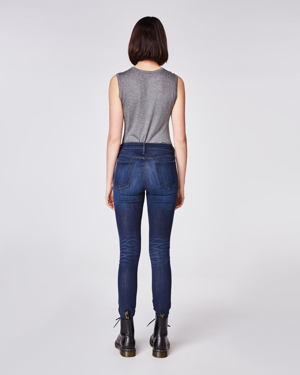 CF10254 - LEATHER AND DENIM JEAN - bottoms - denim - With full leather paneling on the front and denim on the back, these skinny jeans are perfect for day to night wear. Finished with a zipper and button for closure and unlined.