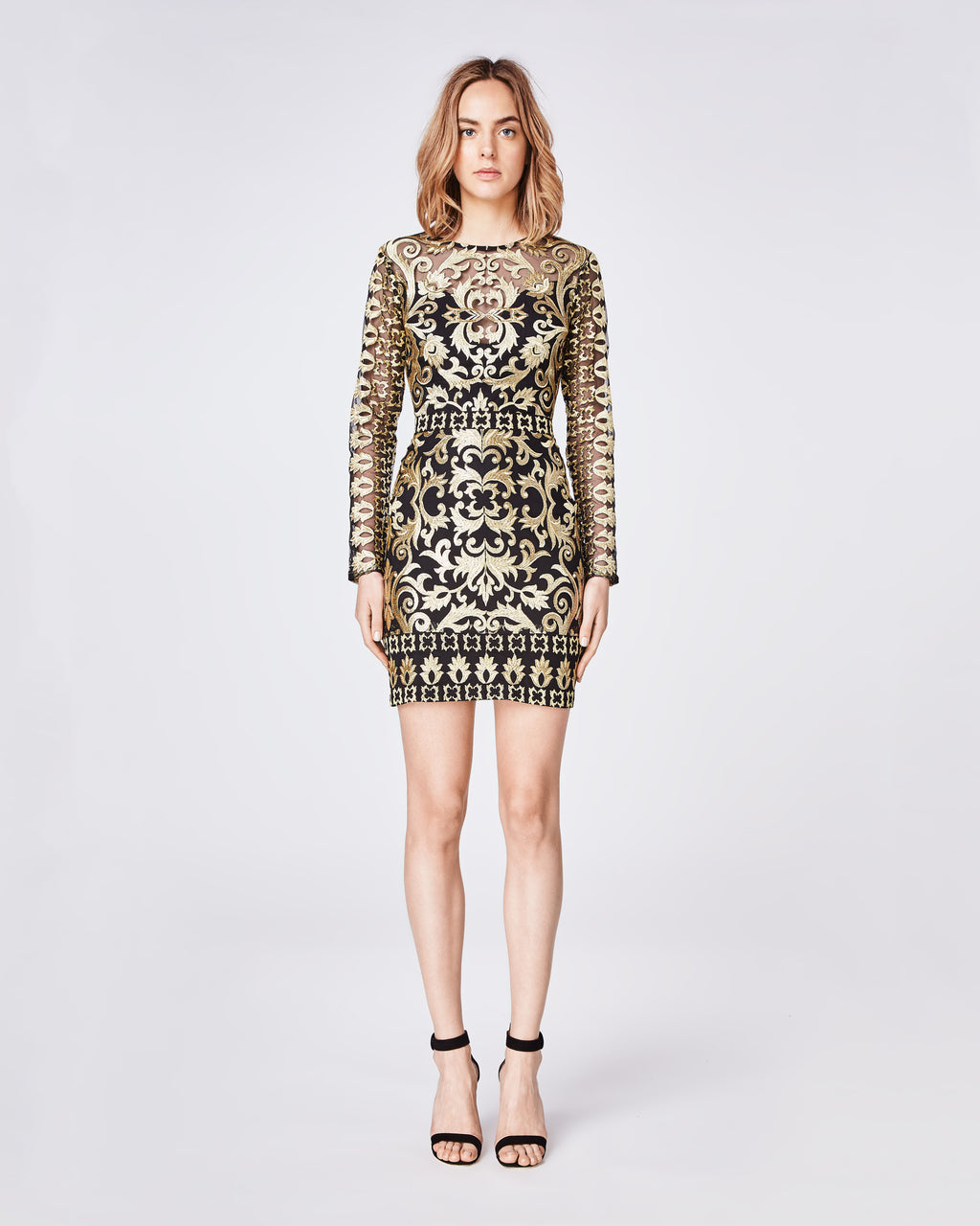 CF10267 - SCROLL EMBROIDERY LONG SLEEVE ILLUSION DRESS - dresses - short - Downtown rocker meets uptown chic in this structured, longsleeve statement dress. It feautures a center back concealed zipper with hook and eye closure. Final Sale