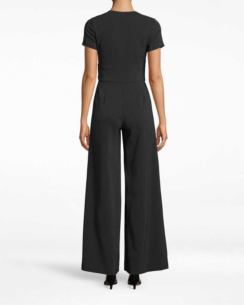 CF20160 - TIE FRONT JUMPSUIT - bottoms - pants - A PARTY IS CALLING, AND THIS JUMPSUIT ANSWERED. IT'S TAILORED WITH A TIE FRONT AND A HIDDEN FRONT ZIPPER AND BUTTON. THE V NECK SHOWS OFF JUST THE RIGHT AMOUNT OF SKIN, WHILE THE ANKLE SKIMMING WIDE LEGS FLARE OUT JUST THE RIGHT AMOUNT. Alternate View