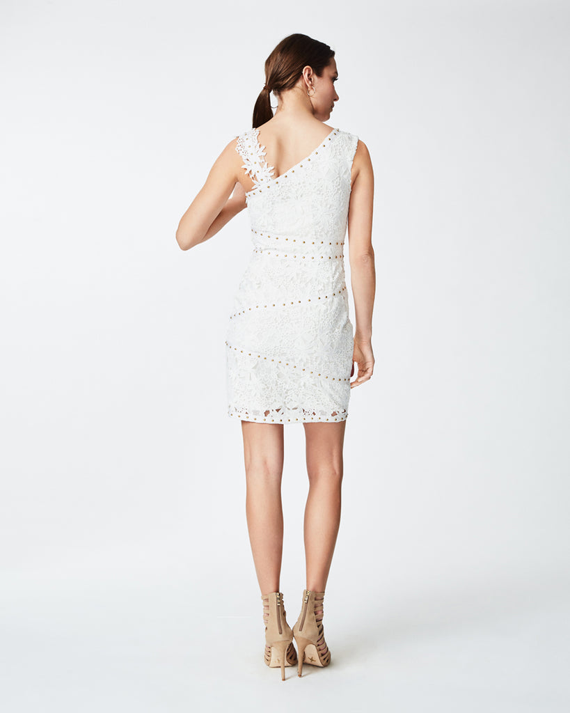 CI10030 - one shoulder lace dress - dresses - short - Details are everything. Nail heads contrast the soft white lace in this one-shoulder dress. Pair with nude sandals and your stunning smile. Concealed zipper for closure, fully lined. Final Sale Alternate View