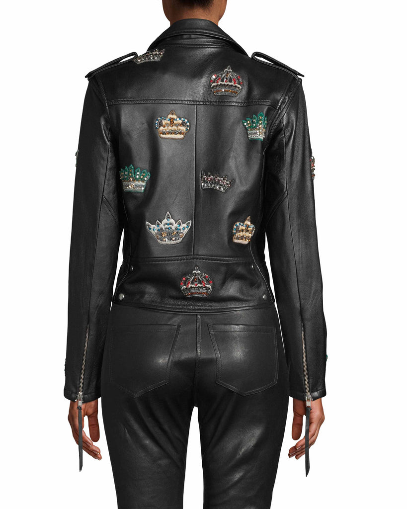 CJ18063 - EMBELLISHED CROWN LEATHER MOTO JACKET - outerwear - leather - As seen on our Fall 2020 Runway, this leather style is designed in a classic moto silhouette with embellished crown patches throughout. This statement style is crafted from soft, 100% leather and features a buckle to cinch the waist. Add 1 line break Stylist tip: Wear over a slip dress for an easy fall transitional look. Alternate View