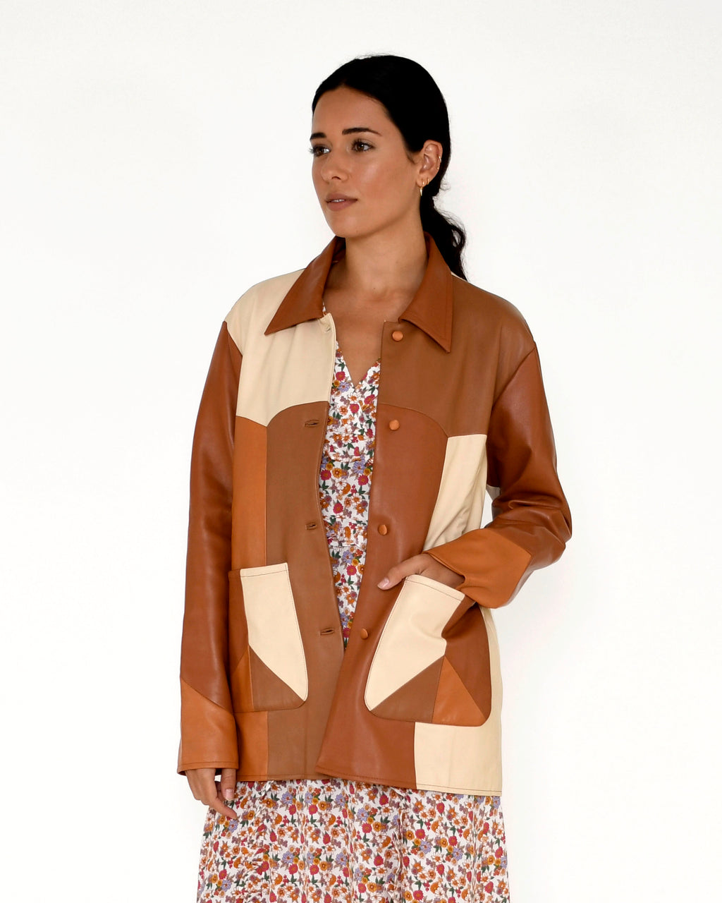 CJ18796 - PATCHWORK LEATHER JACKET - outerwear - leather - A leather jacket is an essential for any closet, and this one is designed in an array of warm neutral browns. Crafted from soft and buttery leather, this mid length jacket features a sunset silhouette on the back and deep front pockets. Add 1 line break Stylist Tip: Pair with anything in our sunshine paradise print for a standout look.