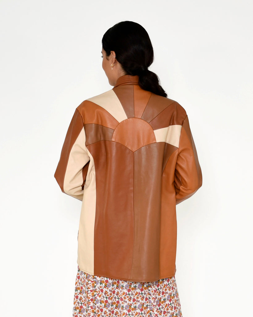CJ18796 - PATCHWORK LEATHER JACKET - outerwear - leather - A leather jacket is an essential for any closet, and this one is designed in an array of warm neutral browns. Crafted from soft and buttery leather, this mid length jacket features a sunset silhouette on the back and deep front pockets. Add 1 line break Stylist Tip: Pair with anything in our sunshine paradise print for a standout look. Alternate View
