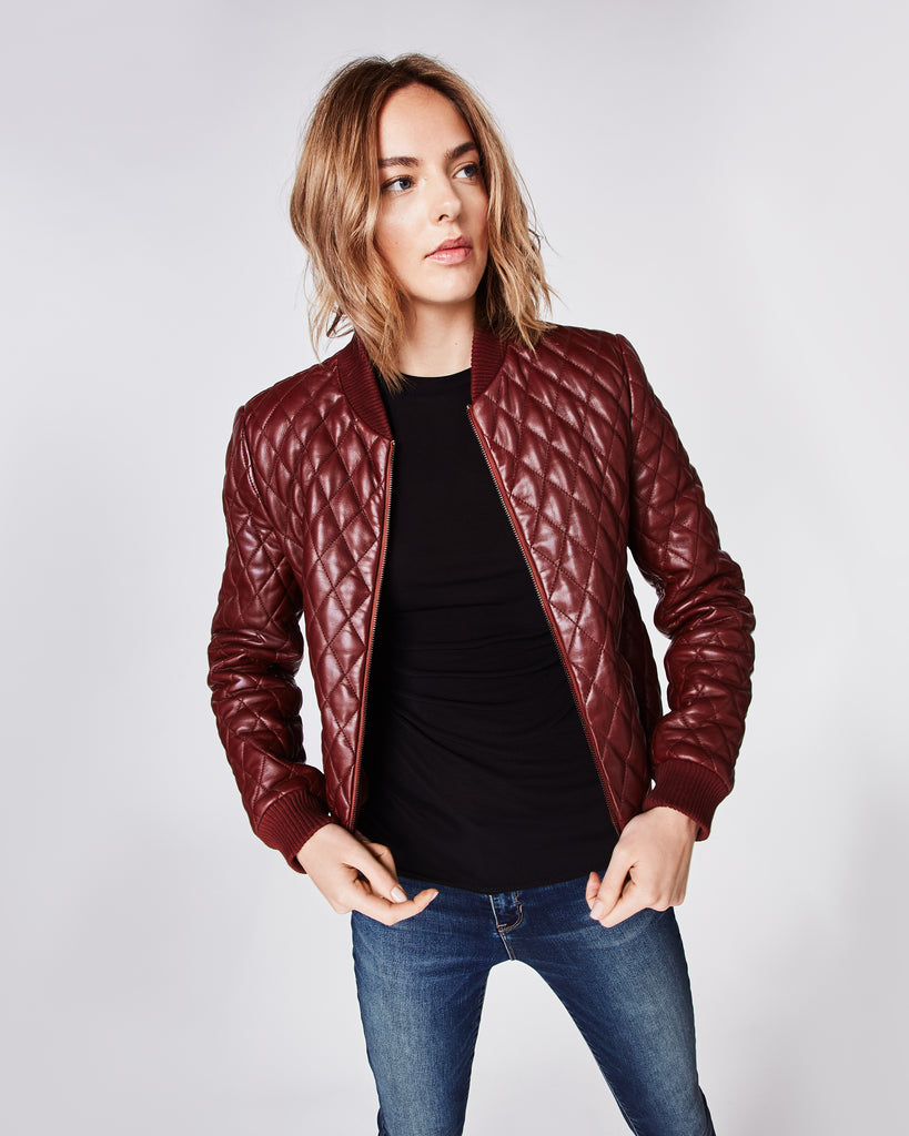 CK10020 - QUILTED LEATHER BOMBER JACKET - outerwear - leather - Welt pockets frame the center zip placket of this quilted leather bomber jacket. Finished with ribbed cuffs and fully lined. Alternate View