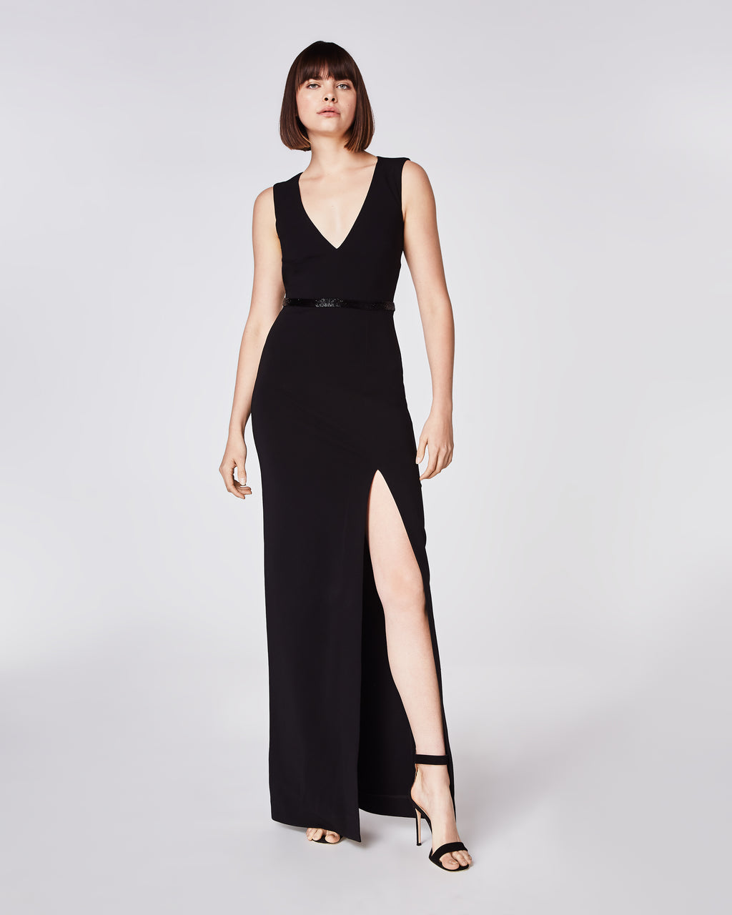 CK10069 - STRUCTURED HEAVY JERSEY V NECK OPEN BACK GOWN - dresses - long - The only black tie dress you will ever need. This black jersey gown features a thigh high slit and deep v-neckline, complimented with a beaded waistline. Finished with an open back, this dress is fully lined and features a concealed zipper forclosure.
