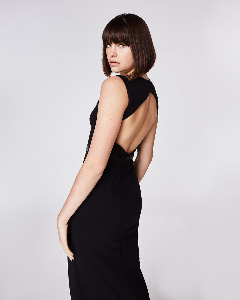 CK10069 - STRUCTURED HEAVY JERSEY V NECK OPEN BACK GOWN - dresses - long - The only black tie dress you will ever need. This black jersey gown features a thigh high slit and deep v-neckline, complimented with a beaded waistline. Finished with an open back, this dress is fully lined and features a concealed zipper forclosure. Alternate View