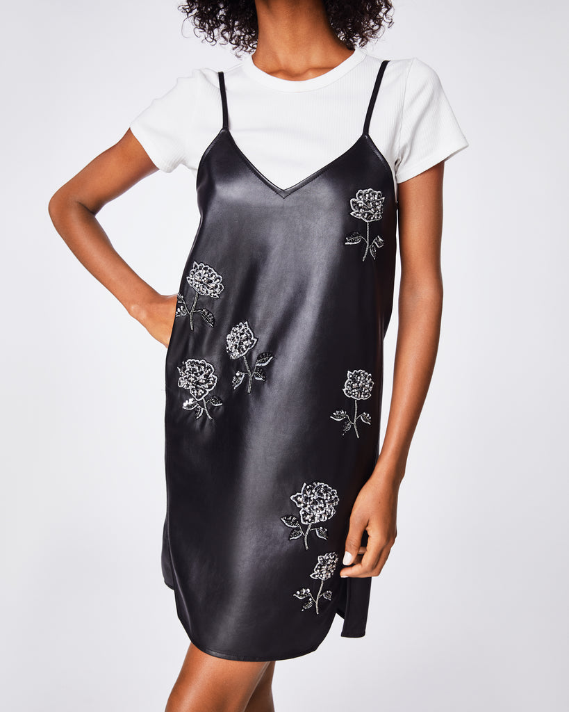 CK10070 - EMBELLISHED ROSE TANK DRESS - dresses - short - In leather with rose embellishments, this spaghetti strap dress style is dowtown cool. Wear with or without shirt layered under it to accomplish a cool or sophisticated look. Alternate View