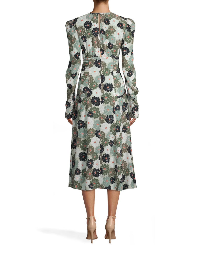 CM17983 - CAMO DELILAH SILK LONG SLEEVE KEYHOLE DRESS - dresses - midi - WITH A BOLD FLORAL PRINT, AIRY SILK FABRIC AND KEYHOLE CUTOUT, THIS MIDI DRESS WAS MADE FOR LATE SUMMER SOIREES. THE SLEEVES FEATURE A SUBLTE PUFF DETAIL WHILE THE WAIST IS RUCHED FOR A SLIMMING FIT. KEYHOLE BACK WITH BUTTONS FOR CLOSURE. Add 1 line break STYLIST TIP: WEAR WITH NEUTRAL HEELS AND SIMPLE JEWELRY. Alternate View