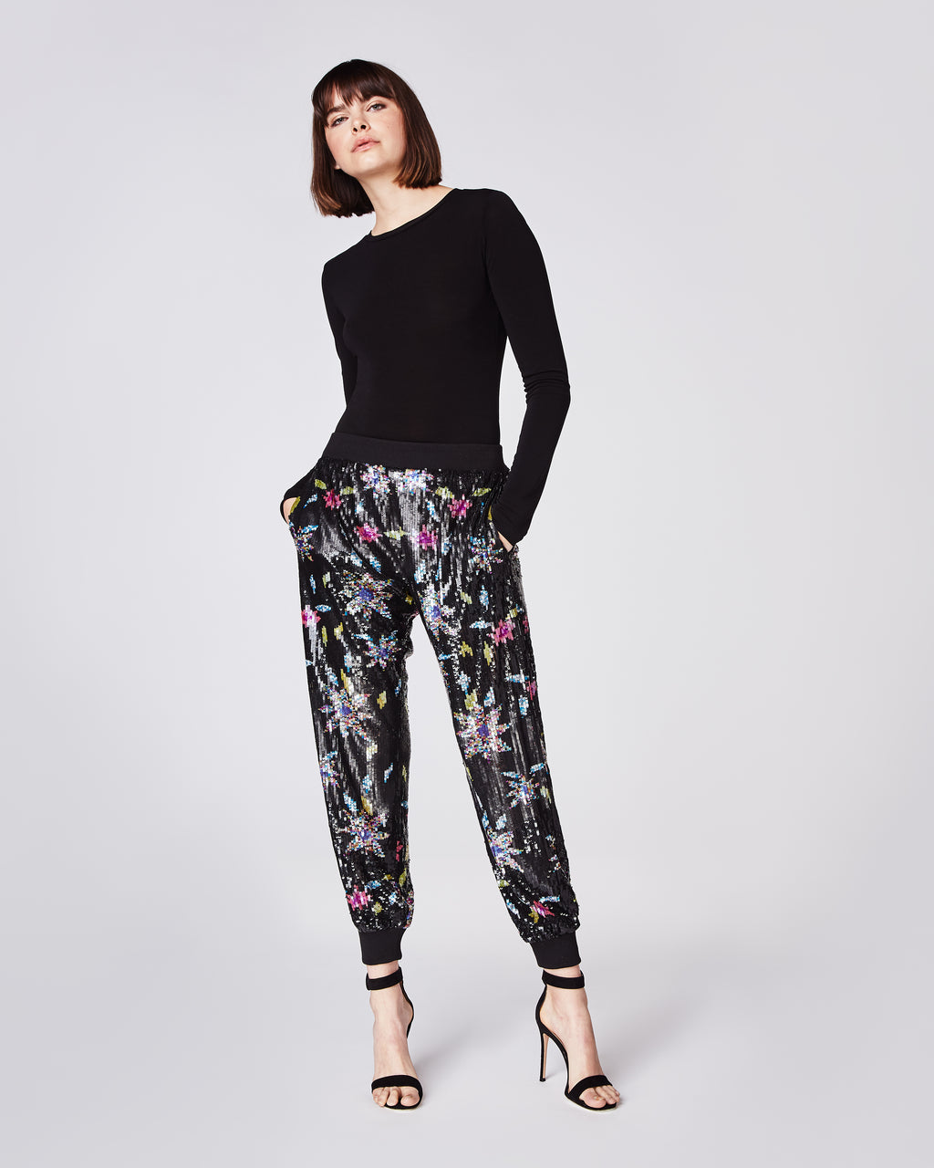 CO10113 - DAHLIA SEQUIN JOGGER - bottoms - pants - An update to our classic jogger, these full sequinpants feature an elastic waist band and cuffs. Pair with a strappy sandal and black top for a chic and sporty look. Fully lined.