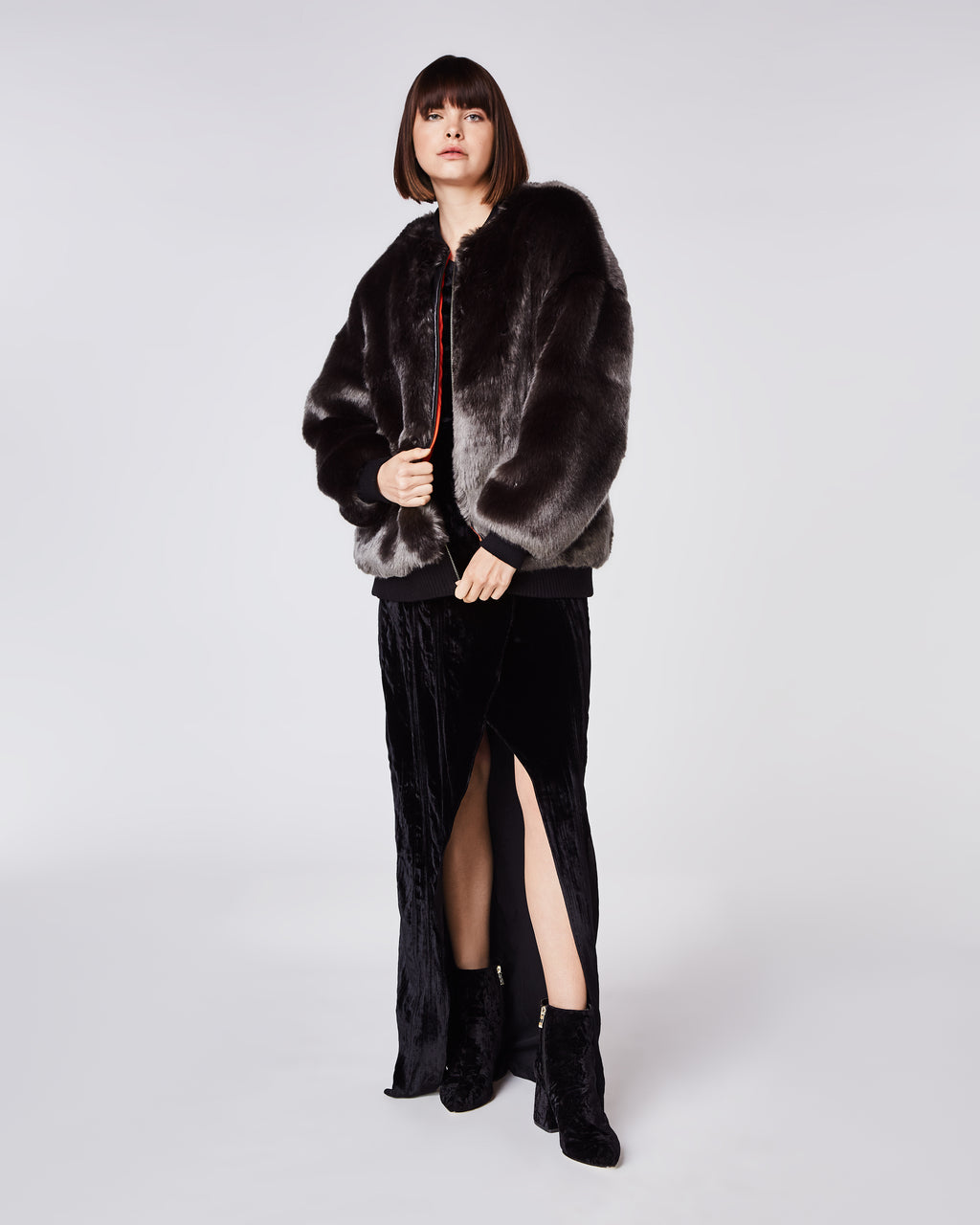 CO10118 - LUXE FAUX FUR BOMBER JACKET - outerwear - coats - In a smoky faux fur, this oversized bomber features a contrasting orange lining and elastic cuffs. Finished with an exposed zipper for closureand fully lined. Jacket is meant to fit oversized.For a more fitted fit, please order one size down.