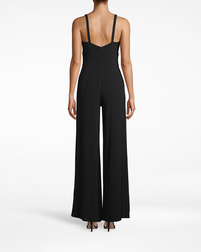 "CP18064 - SATIN BACK CREPE ""MOLLY"" JUMPSUIT - bottoms - pants - THIS CLASSIC JUMPSUIT EASILY TRANSITIONS FROM SEASON TO SEASON. MADE FROM SMOOTH SATIN BACK CREPE WITH SPAGHETTI STRAPS AND A SLIGHT PLEATED FRONT. Add 1 line break STYLIST TIP: WEAR WITH A DENIM JACKET AND SNEAKERS FOR A CASUAL LOOK OR HEELS AND STATEMENT FOR DRESSY OCCASIONS. Alternate View"
