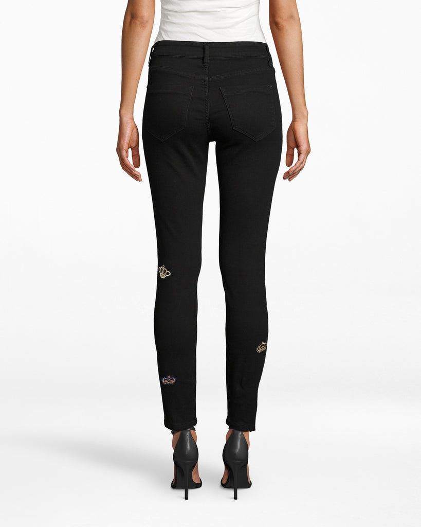 CP18298 - CROWN DENIM JEAN - bottoms - pants - Designed in our best selling Soho silhouette, these are not your basic black jeans. Crafted from soft, stretchy denim with crown patches throughout. Matte black hardware. Add 1 line break Stylist tip: Pair back with a basic top to let these statement jeans shine. Alternate View