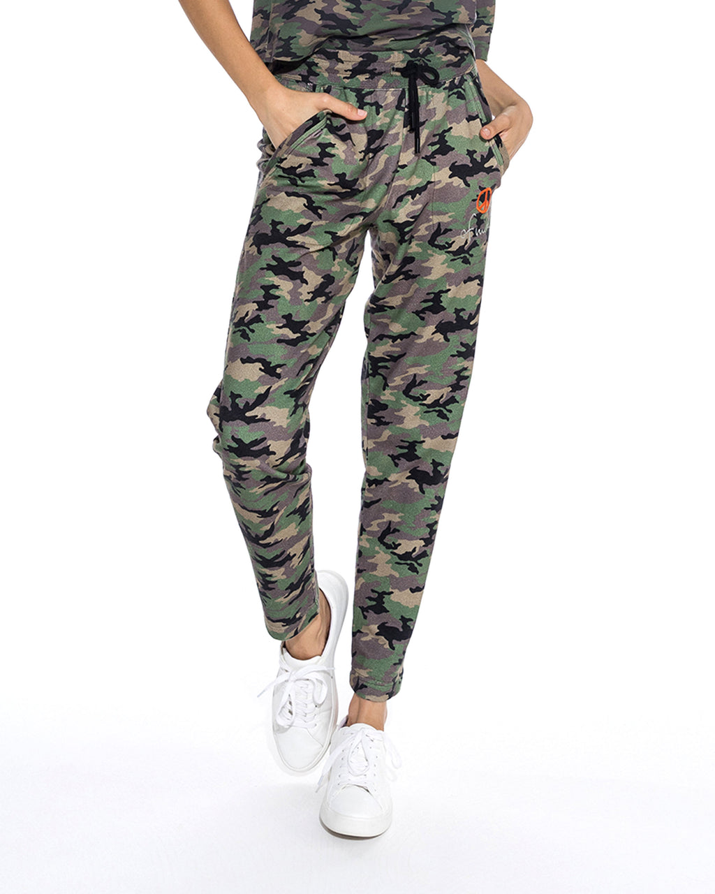 "CP18593 - CAMO JOGGER - bottoms - pants - A closet essential. These camo joggers can instantly dress up any plain t-shirt. Featuring a classic jogger fit, drawstring waist and ""peace of mind"" embroidery on the left hand pocket. Add 1 line break Stylist tip: Pair with a classic black tee and chunky gold jewelry."