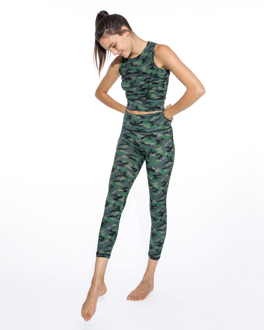 CP18602 - CAMO LEGGINGS - bottoms - pants - Our new camo leggings easily transition from lounge to streetwear. These lightweight leggings are flexible, soft and come in a camo blush or camo green colorway. These high wasit pants hit just at the ankle. Add 1 line break Stylist tip: Pair with the matching crop top and a jean jacket.
