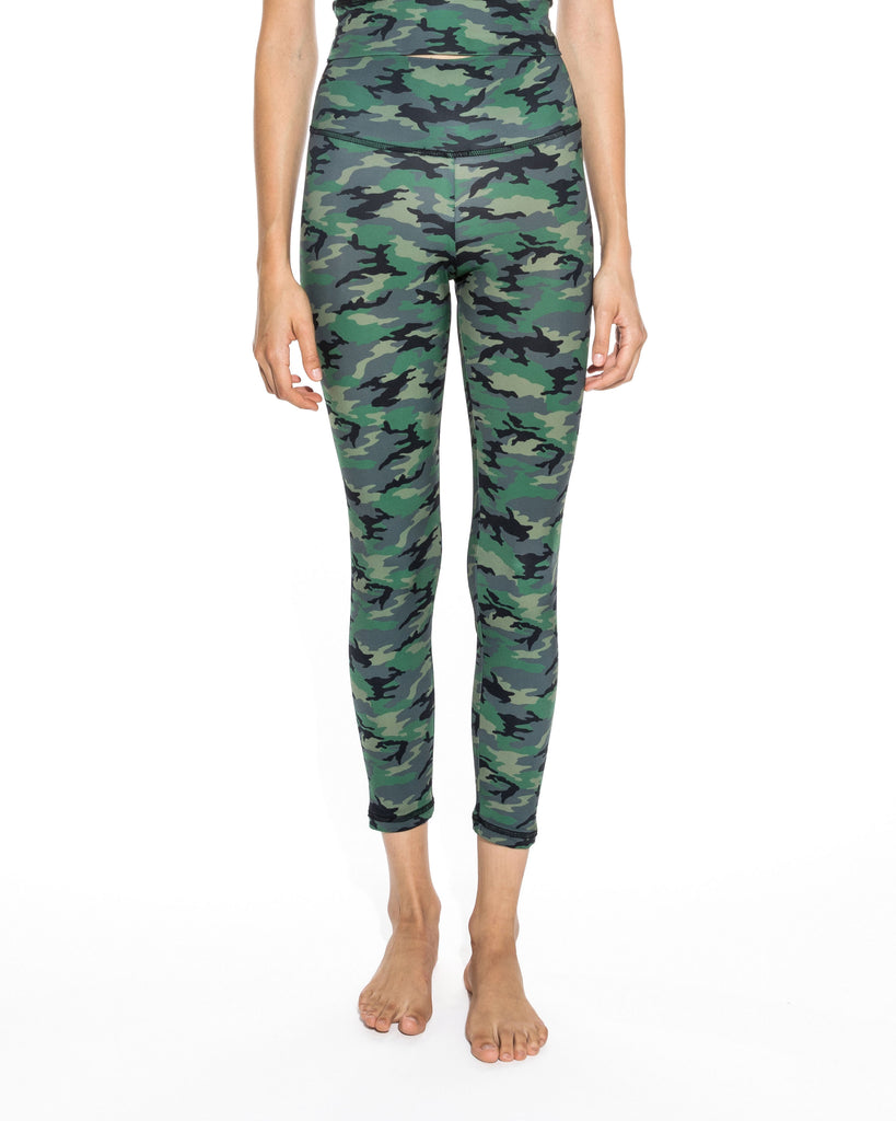 CP18602 - CAMO LEGGINGS - bottoms - pants - Our new camo leggings easily transition from lounge to streetwear. These lightweight leggings are flexible, soft and come in a camo blush or camo green colorway. These high wasit pants hit just at the ankle. Add 1 line break Stylist tip: Pair with the matching crop top and a jean jacket. Alternate View
