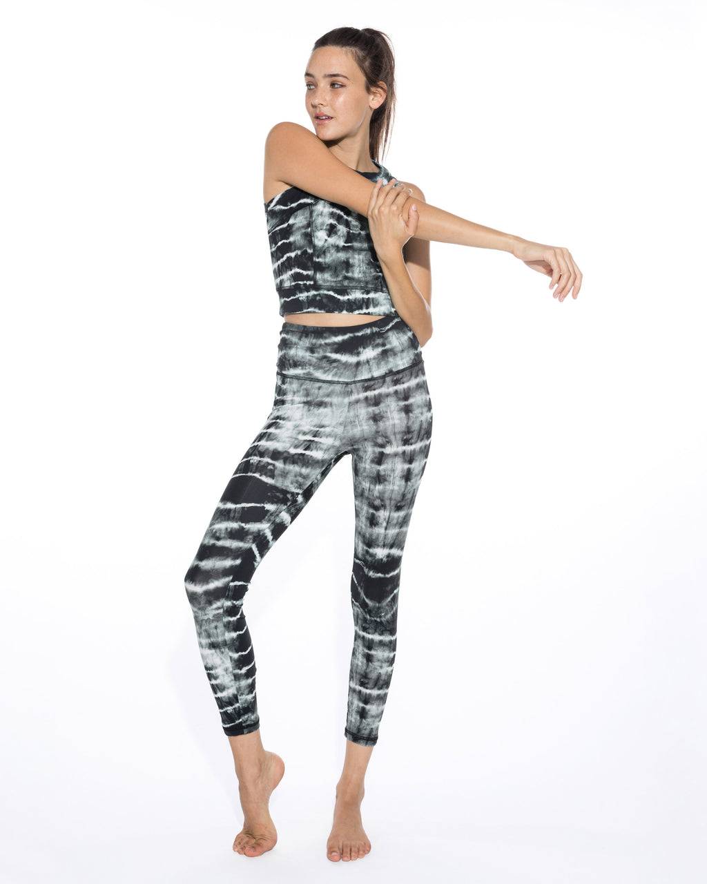 CP18610 - TIE DYE LEGGINGS - bottoms - pants - Fitness and style have never paired so well together. These leggings are printed in black and white tie dye with a high wasit and hit just above the ankle. Add 1 line break Stylist tip: Pair with the matching top for a monochrome look.