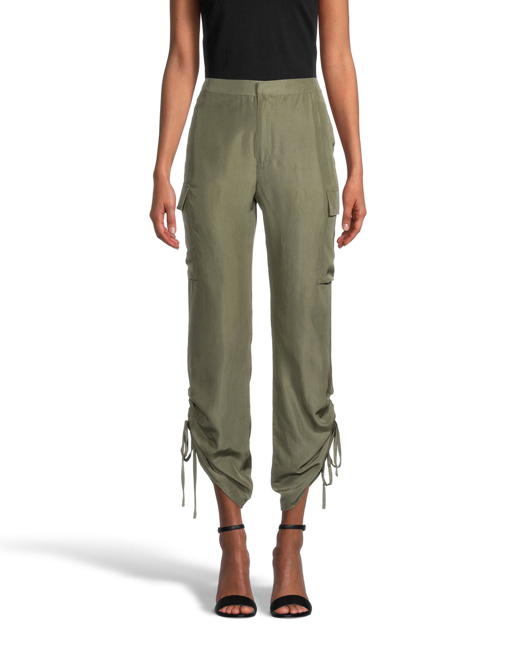 CP18680 - SOLID SILK CARGO PANT - bottoms - pants - Made from 100% silk, this silhouette gives cargo pants a feminine update. This slimming style features two pockets on the side and adjustable ruching for added detail. This best selling style is one that will be on repeat all season long. Add 1 line break Stylist Tip: Pair with the matching oversized t-shirt for a complete look.