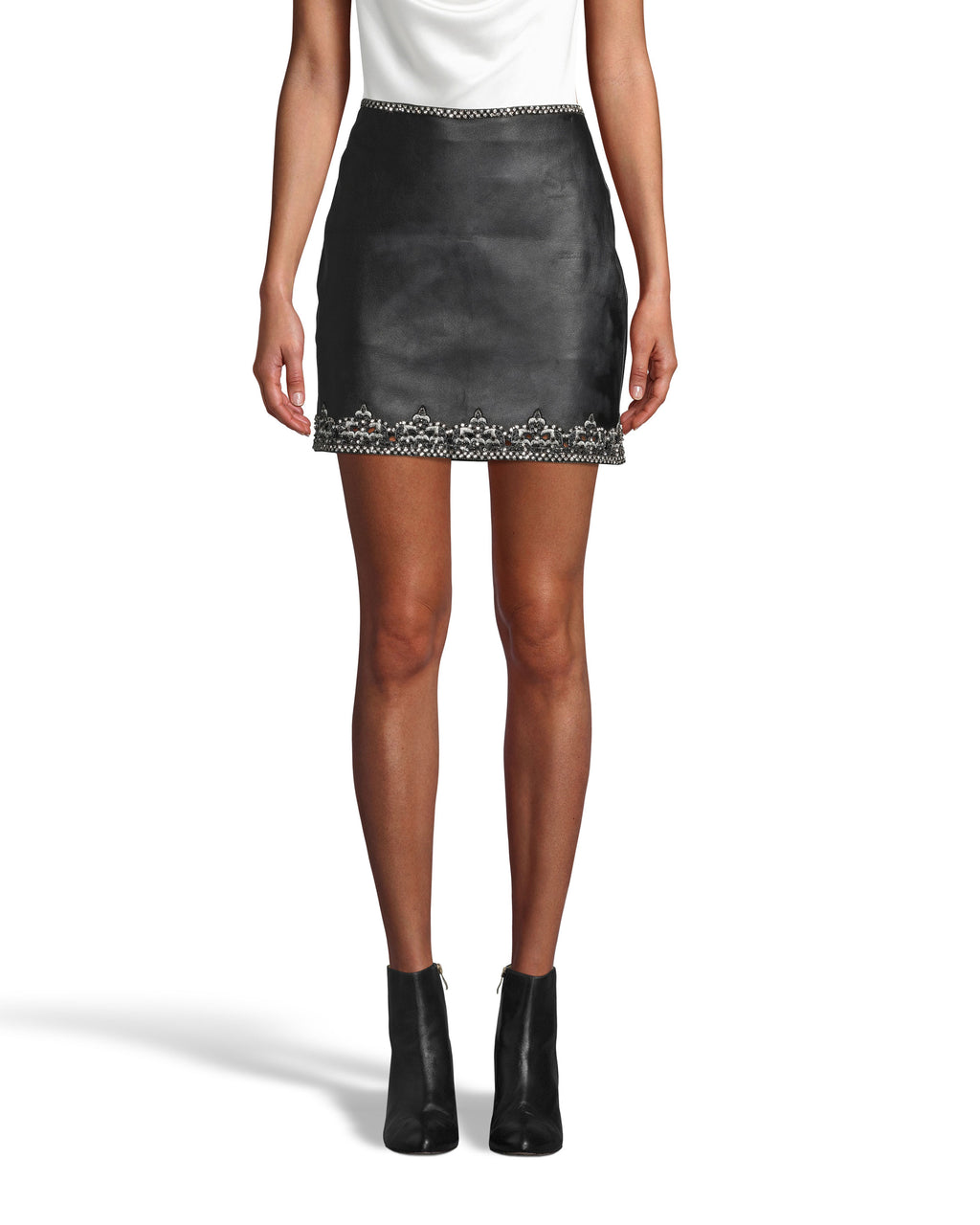 CS17651 - EMBELLISHED CROWN TRIM LEATHER MINI SKIRT - bottoms - skirts - Classic silhouette with added edge. This leather mini skirt features an rhinestone and sequin crown trim along the hem and waistband. Back zipper for closure. Add 1 line break Stylist tip: Pair with a white top for a simple statement look.