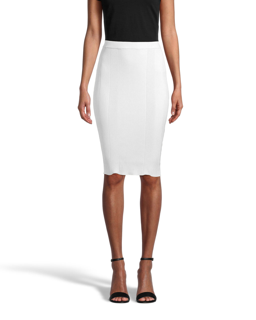 CS18566 - KNIT PENCIL SKIRT - bottoms - skirts - Designed in a super soft ribbed fabrication, this pencil skirt hugs and flatters your curves for a classic and flattering effect. This pull on piece is easy yet elevated and hits just above the knee for a full coverage fit. Add 1 line break Stylist tip: Pair with one of our printed button downs for a professional yet stylish look.