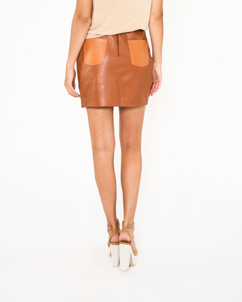 CS18795 - LEATHER PATCHWORK SKIRT - bottoms - skirts - Our patchwork leather mini skirt is designed in buttery leather in rich brown and beiges hues. Pieces are stitched together to create a sunset silhouette along the right hand pocket. Back zipper for closure. Add 1 line break Stylist Tip: Pair with a lightweight sweater and tall brown boots. Alternate View