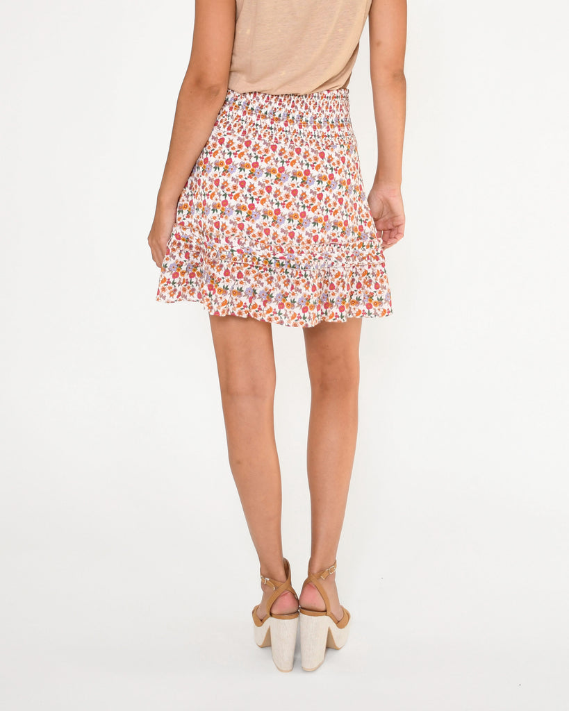 CS18932 - SUNSHINE PARADISE MINI SKIRT - bottoms - skirts - A bold floral print and feminine ruffles make this mini skirt a spring essential. Featuring a flattering smocked waist. Add 1 line break Stylist Tip: Pair with a white t-shirt for a laid back yet put together look. Alternate View