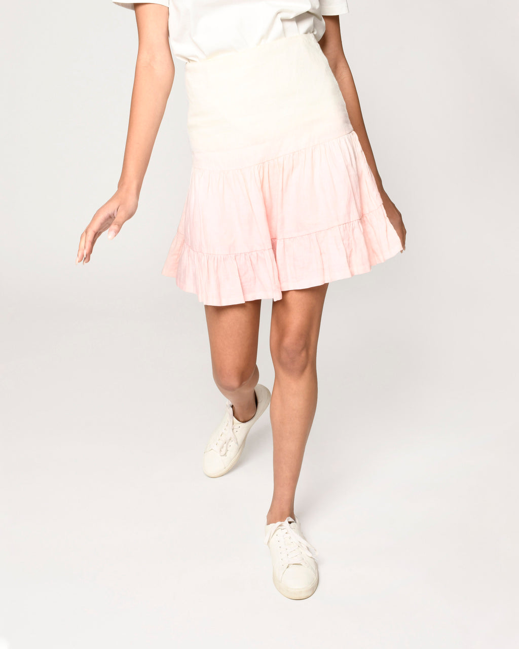 CS19058 - DIP DYE LINEN MINI SKIRT - bottoms - skirts - This flirty mini skirt is dip dyed in colorful pink and yellow ombr� and is designed in lightweight linen. This hand dyed piece features a ruffle hem and a zip closure. Add 1 line break Stylist Tip: Pair with our ivory linen crop top for a perfect spring set.