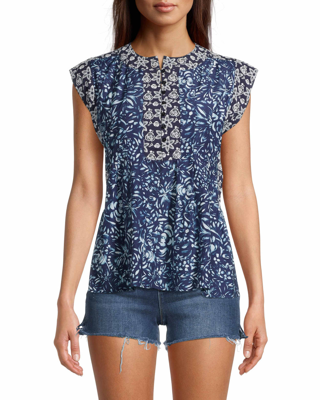 CT18534 - EVENING GARDEN EMBROIDERED SLEEVELESS BLOUSE - tops - blouses - Designed in our new evening garden print, this sleeveless blouse is embroidered with pretty floral details on the front and sleeves. Featuring subtle navy buttons up the front. Add 1 line break Stylist Tip: Pair with our cashmere poncho.