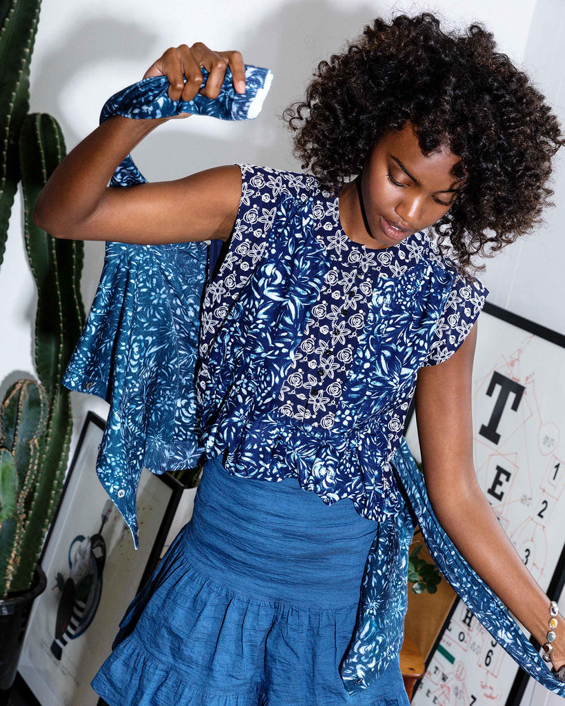 CT18534 - EVENING GARDEN EMBROIDERED SLEEVELESS BLOUSE - tops - blouses - Designed in our new evening garden print, this sleeveless blouse is embroidered with pretty floral details on the front and sleeves. Featuring subtle navy buttons up the front. Add 1 line break Stylist Tip: Pair with our cashmere poncho. Alternate View