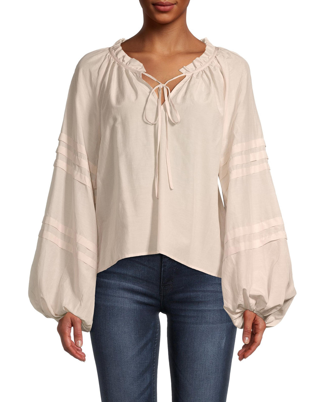 CT18573 - SOLID PEASANT BLOUSE - tops - blouses - Feminine and effortless, this lightweight peasant blouse features a ruffled neckline which can be left tied or untied, and subtle stripes on the puffed sleeves. Cut in a creamy parchment color. Add 1 line break Stylist Tip: Tuck into your favorite denim.