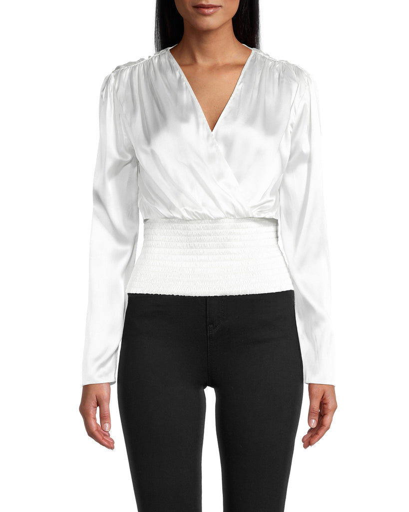 CT18581 - SOLID STRETCH CHARMEUSE TOP - tops - blouses - Charming charmeuse. This silky top has a deep v-neck wrapped front and a flattering smocked waist. Our charmeuse is soft to the touch and has just the right amount of shine for a subtle standout piece. Add 1 line break Stylist tip: Pair with black jeans and a leather jacket. Alternate View