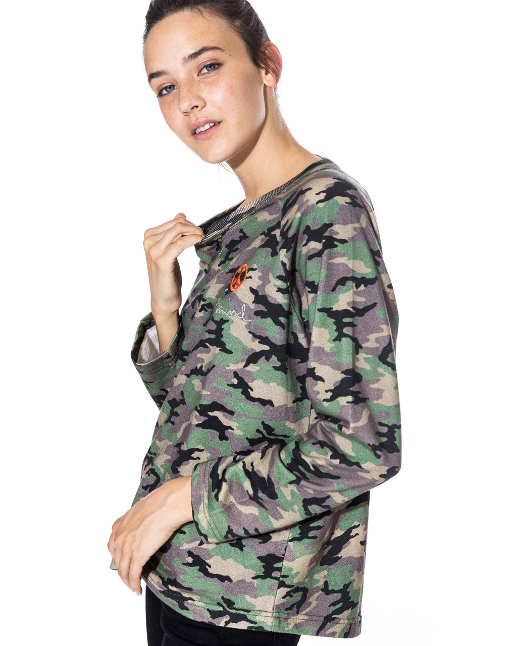 "CT18599 - CAMO CREW NECK SWEATSHIRT - tops - knitwear - Our new long sleeve camo sweatshirt is designed in a blush pink and classic camo colorway. Featuring a slightly raw hem and ""peace of mind"" embroidery. Add 1 line break Stylist tip: Wear with your favorite jeans and white sneakers."