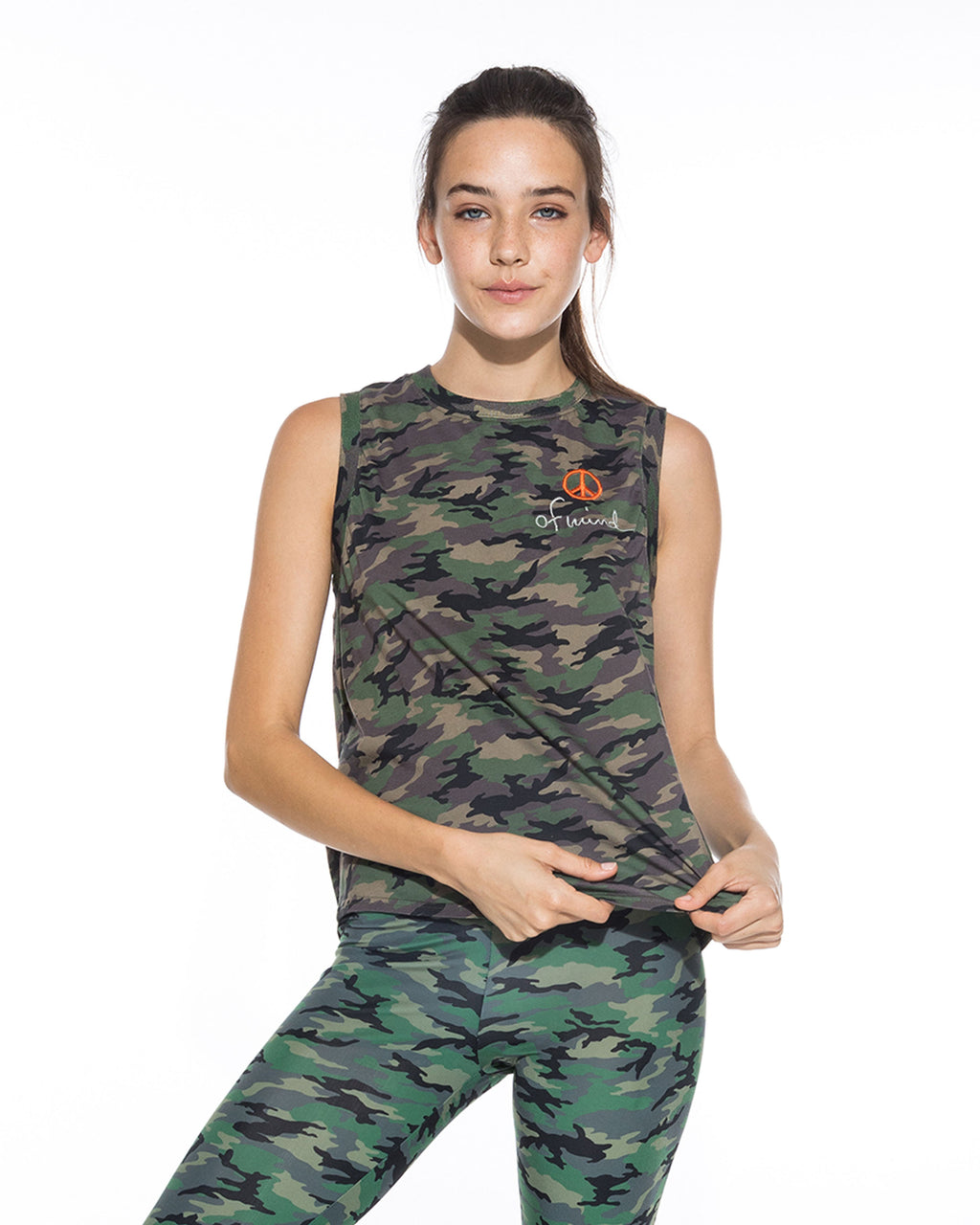 CT18600 - CAMO MUSCLE T-SHIRT - tops - shirts - This lightweight tee is crafted from 100% cotton. Designed in a classic muscle tee silhouette in classic camoflauge print in blush or green. Add 1 line break Stylist tip: Dress this top up by pairing with black denim.