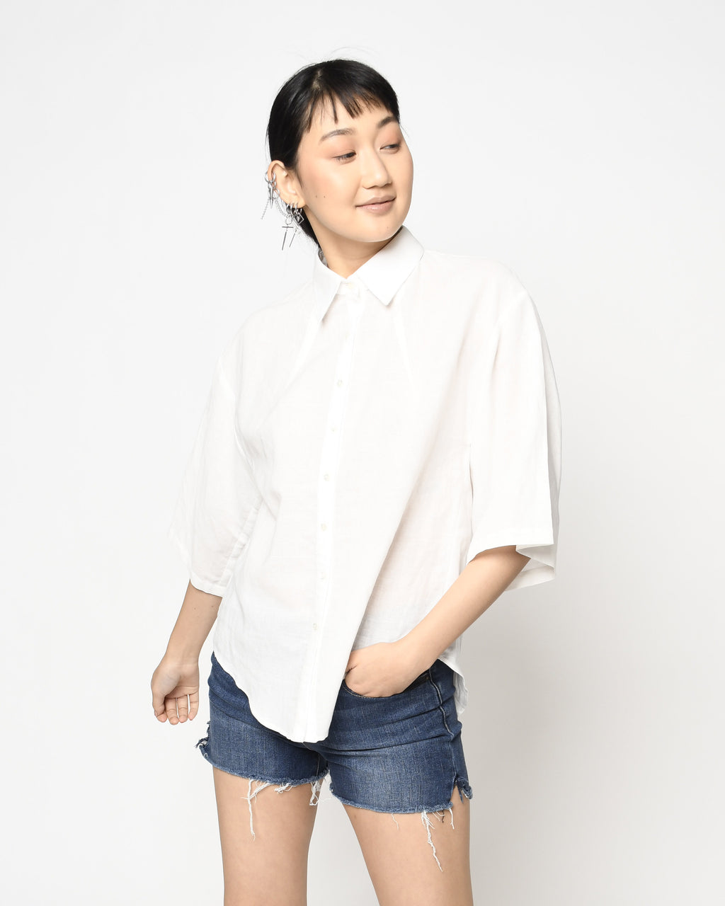CT18738 - LINEN CAMP SHIRT - tops - shirts - This linen shirt is an essential for any wardrobe.Designed in lightweight yet luxurious linen, this boxy shirt button downs the front and features 3 quarter length sleeves. Add 1 line break Stylist Tip: Dress up with jeans or wear over a bathing suit for a chic cover up.